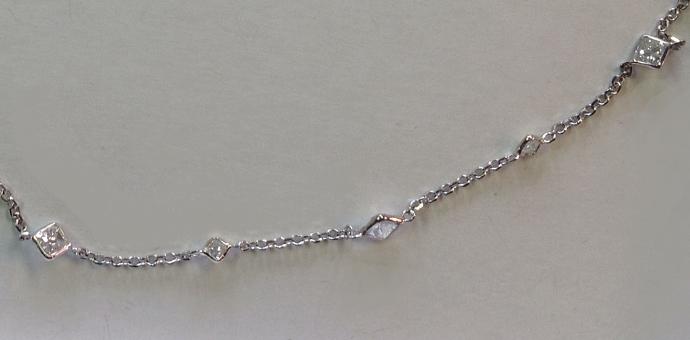 Several princess cut diamonds, very delicate necklace