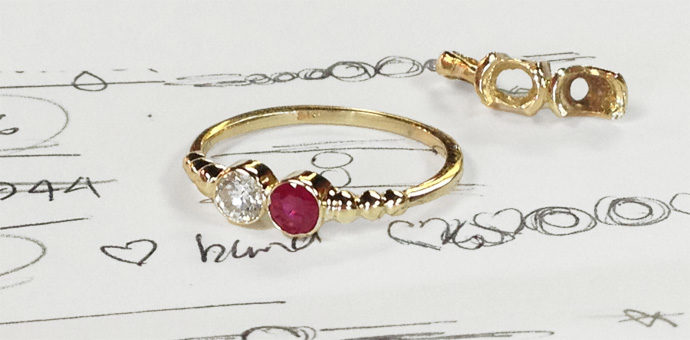 ruby and diamond mothers ring. redesigned from old pendant which is in the background. all on top of design sketch
