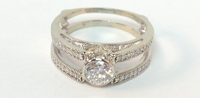 white gold filigree wedding ring with channel diamonds - full front view