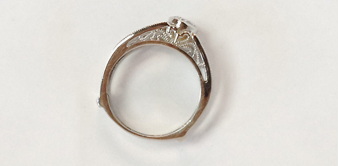 side view white gold filigree wedding ring with channel diamonds - wedding diamond repurposed
