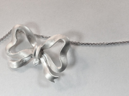 sterling silver tied in a bow, a sweet necklace for girl