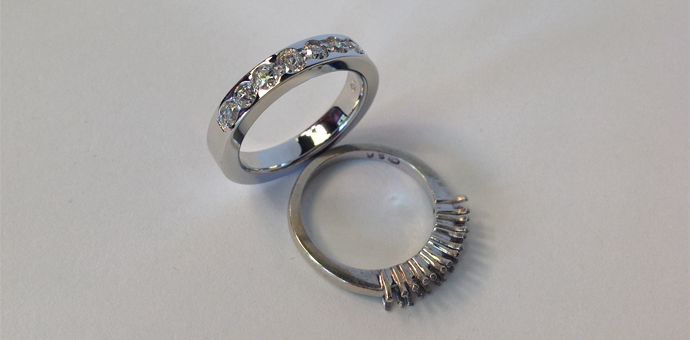 redesigned ring took stones from prongs. new white gold rings has diamonds in channels (indentations)