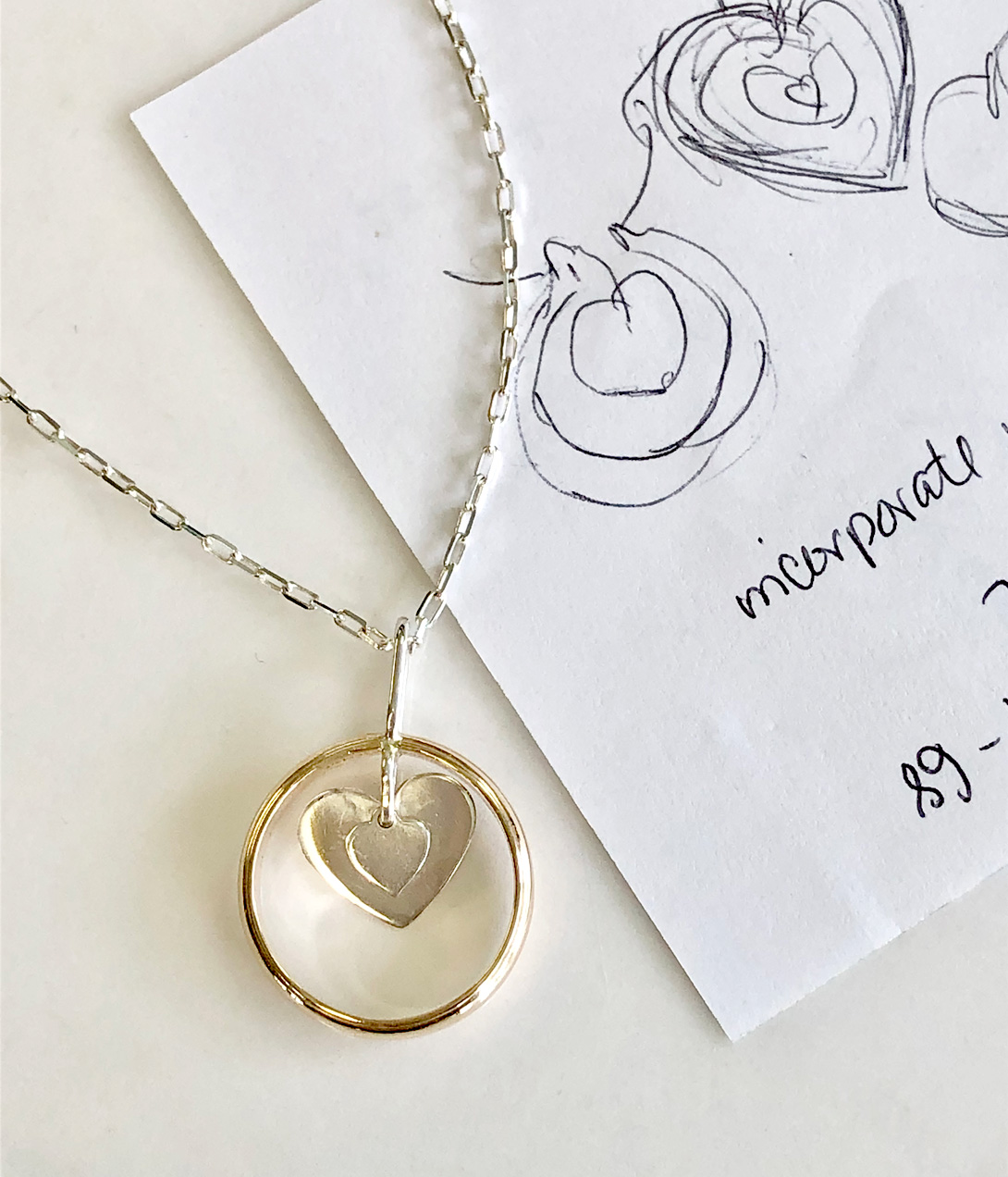 double heart pendant with design sketches