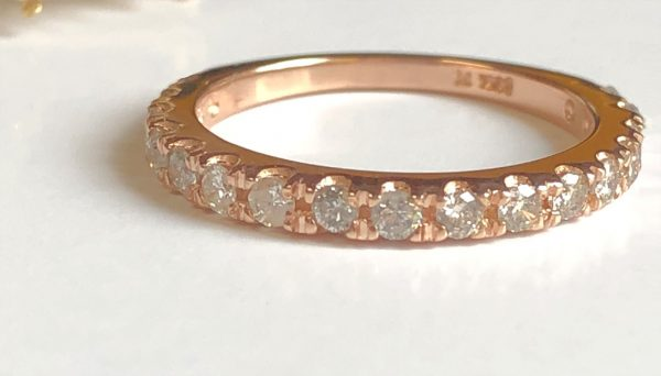rose gold wedding band with 17 full cut diamonds