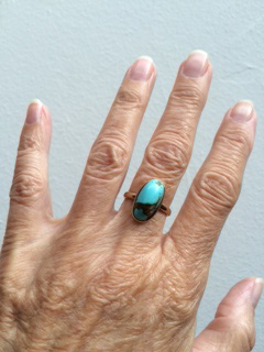 solitaire turquoise ring on hand - happy purchase