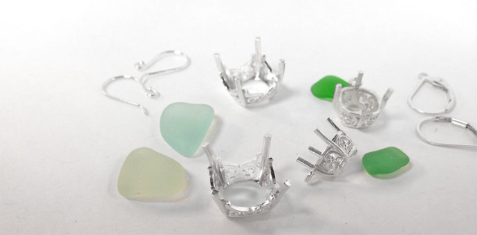 sea glass and silver earring components before assembly