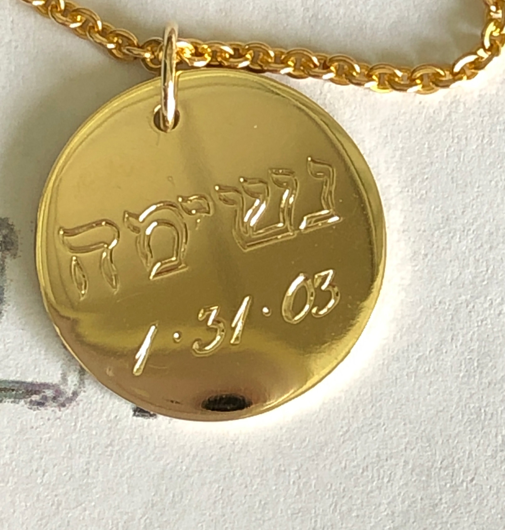 grandaughter's birthdate and Hebrew name engraved on pendant