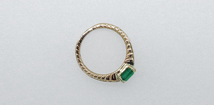 Side view shows nice texture of the emerald ring