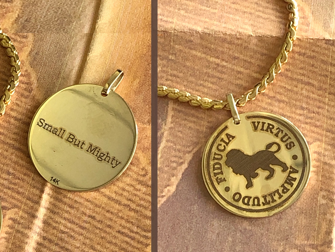 """Final 14k gold pendant replicated from lion costume design, has """"Small But Mighty"""" mantra on side two"""