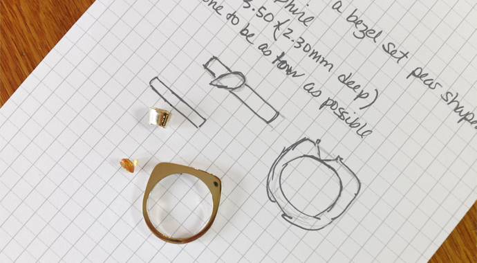 Yellow sapphire and ring form with jeweler's design notes on graph paper