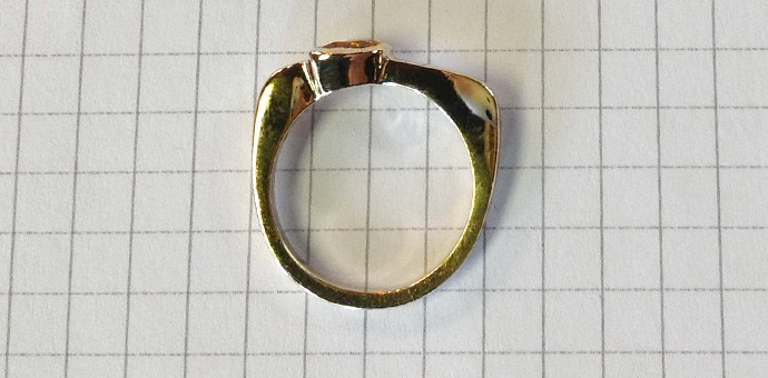 Portrait (side) fiew of ring shows the overall asymmetric shape of the ring - very RH Weber!