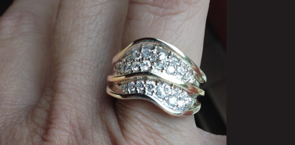 two-layer undulating wave ring with pave set diamonds