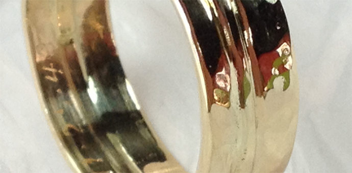 gold wedding band with inscription. three seperate rings repurposed