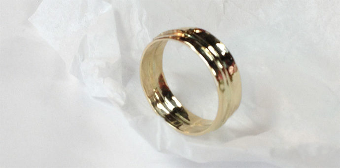 gold wedding band reconstructed from three beloved rings
