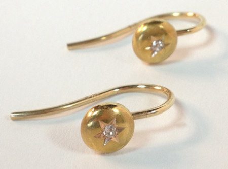 front view of gold star diamond earrings made from tuxedo buttons