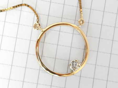 final necklace shows circle with diamond