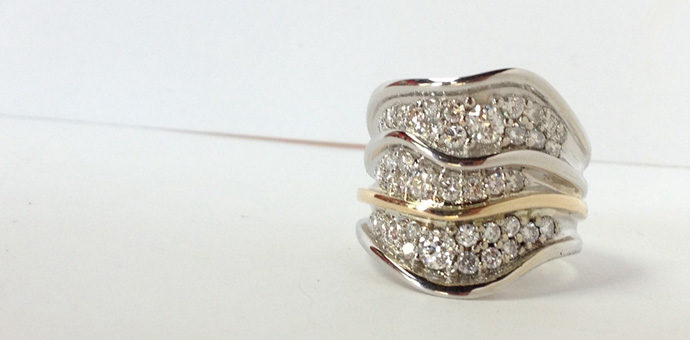 three layer wave ring with 38 pave set diamonds from family members