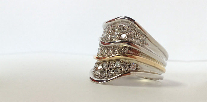 white and yellow gold wave ring. reused diamonds from family members are pave set
