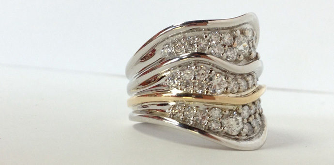 side view and milage of diamonds fill the ring sections