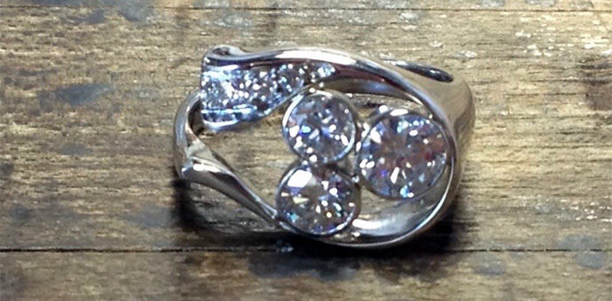 three bezels added for setting the added family diamonds