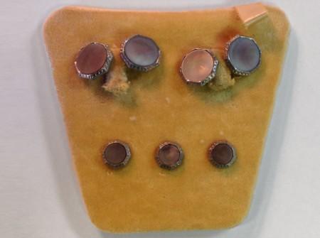 2 sets of round cufflinks on saffron velvet box interior plus 3 studs for your tux