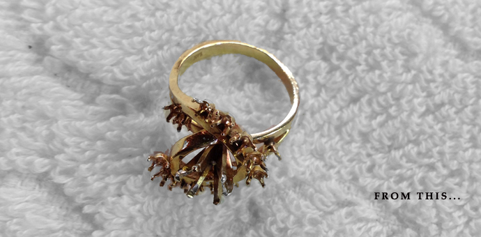 Gold ring with flowery prongs and tiny diamonds