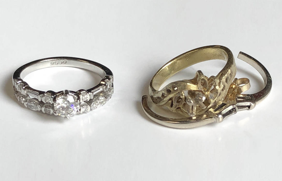 finished new platinum ring next to old ring + earrings