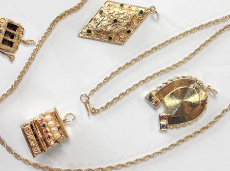 necklace clasp attaches to replaceable charms as pendants